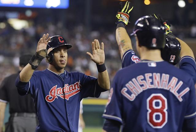 Cleveland Indians' Michael Brantley greets teammates after scoring on a three-run double by teammate Carlos Santana during the ninth inning in the second baseball game of a doubleheader against the Detroit Tigers, Saturday, July 19, 2014 in Detroit. (AP Photo/Carlos Osorio)