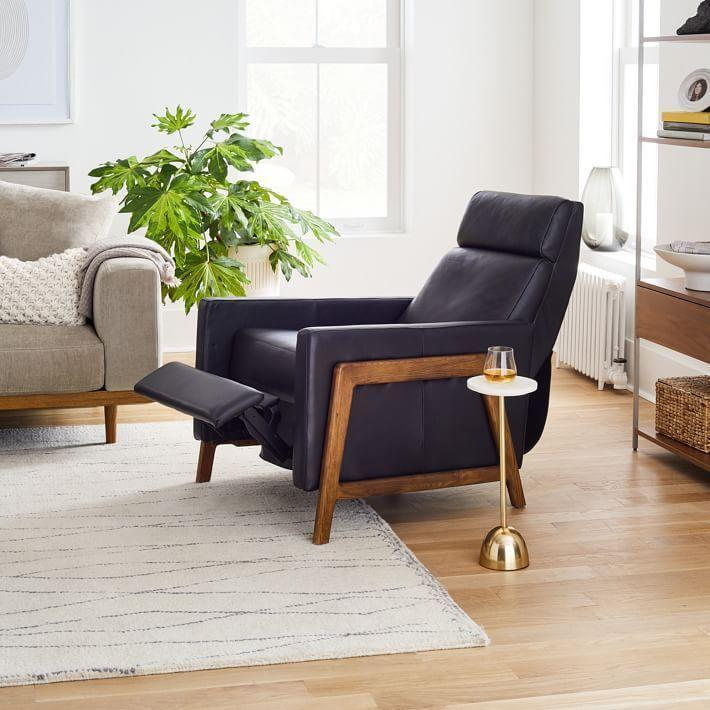 "<p>westelm.com</p><p><strong>$1399.00</strong></p><p><a href=""https://go.redirectingat.com?id=74968X1596630&url=https%3A%2F%2Fwww.westelm.com%2Fproducts%2Fspencer-wood-framed-recliner-h1206&sref=https%3A%2F%2Fwww.housebeautiful.com%2Fshopping%2Ffurniture%2Fg3816%2Fcozy-couches-and-chairs%2F"" rel=""nofollow noopener"" target=""_blank"" data-ylk=""slk:Shop Now"" class=""link rapid-noclick-resp"">Shop Now</a></p><p>If recliners are your thing, go for a more stylish look without sacrificing comfort with this cushy leather recliner.</p>"