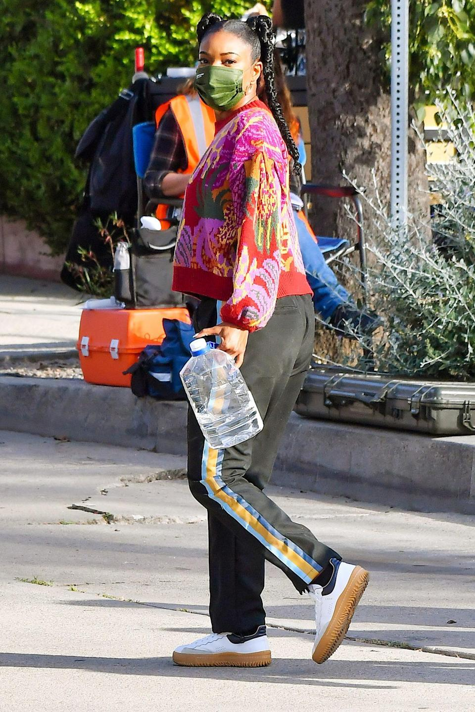 <p>Gabrielle Union carries a water jug as she leaves the set of <em>Cheaper by the Dozen </em>on Thursday in L.A. </p>