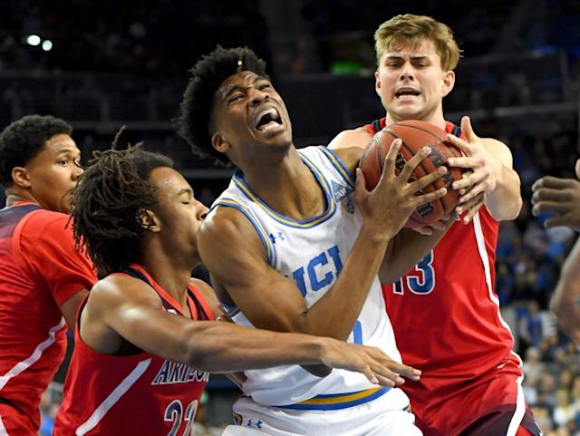 "UCLA guard Chris Smith, center, is among the players who will be deciding soon whether he'll declare for the NBA draft or return for his senior season. <span class=""copyright"">(Jayne Kamin-Oncea / Getty Images)</span>"