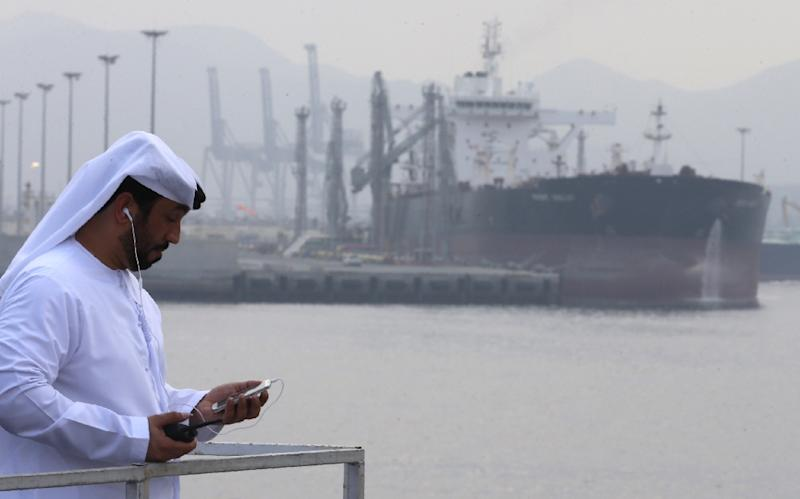 An Emirati man stands at the oil terminal of Fujairah during the inauguration ceremony of a dock for supertankers on September 21, 2016