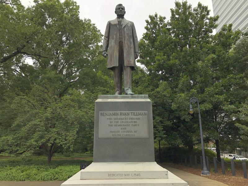 """A statue of """"Pitchfork"""" Ben Tillman is seen outside the South Carolina Statehouse on Tuesday, June 16, 2020, in Columbia, South Carolina. Tillman, who was white, led a race riot that killed four black men in 1876. Some activists want his statue removed and Clemson University wants to remove his name from a main campus building.  (AP Photo/Jeffrey Collins)"""