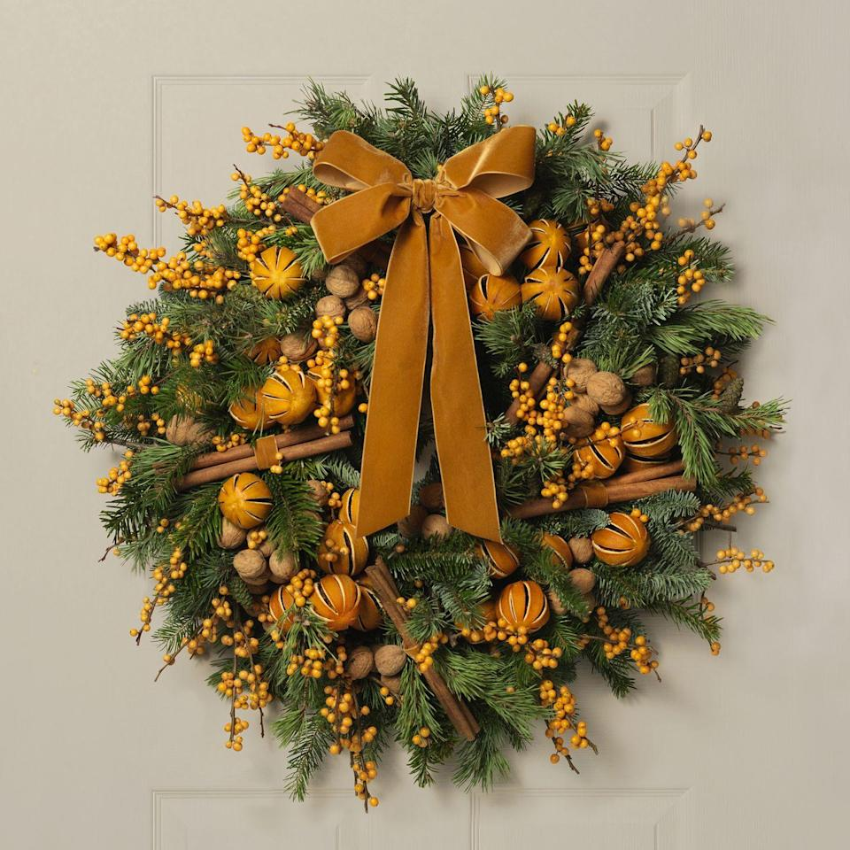 "<p>One of three Christmas collections offered by this London florist in 2020, each named after a famous British photographer. Dedicated to Patrick Lichfield, this is a gloriously fragrant wreath, packed with dried oranges and cinnamon. From £95, <a href=""https://paulthomasflowers.co.uk/product/the-lichfield-gold-wreath/"" rel=""nofollow noopener"" target=""_blank"" data-ylk=""slk:paulthomasflowers.co.uk"" class=""link rapid-noclick-resp"">paulthomasflowers.co.uk</a></p>"