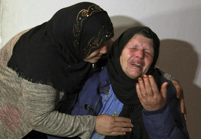 The mother of Brahim Issaoui, who killed three people and wounded several in the French city of Nice, cries at her home on October 29 in the Tunisian city of Sfax after being questioned by the anti-terrorism police