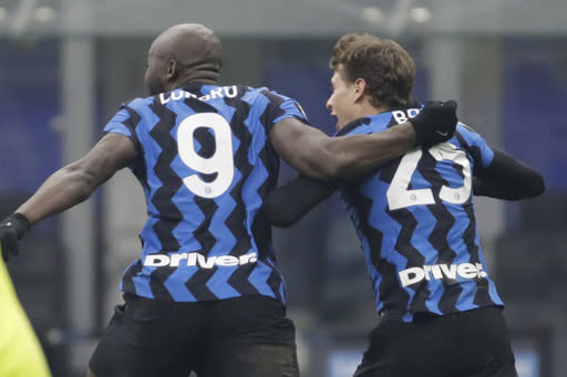 Inter Milan's Nicolo Barella, right, celebrates after scoring his side's second goal during a Serie A soccer match between Inter Milan and Juventus at the San Siro stadium in Milan, Italy, Sunday, Jan. 17, 2021. (AP Photo/Luca Bruno)