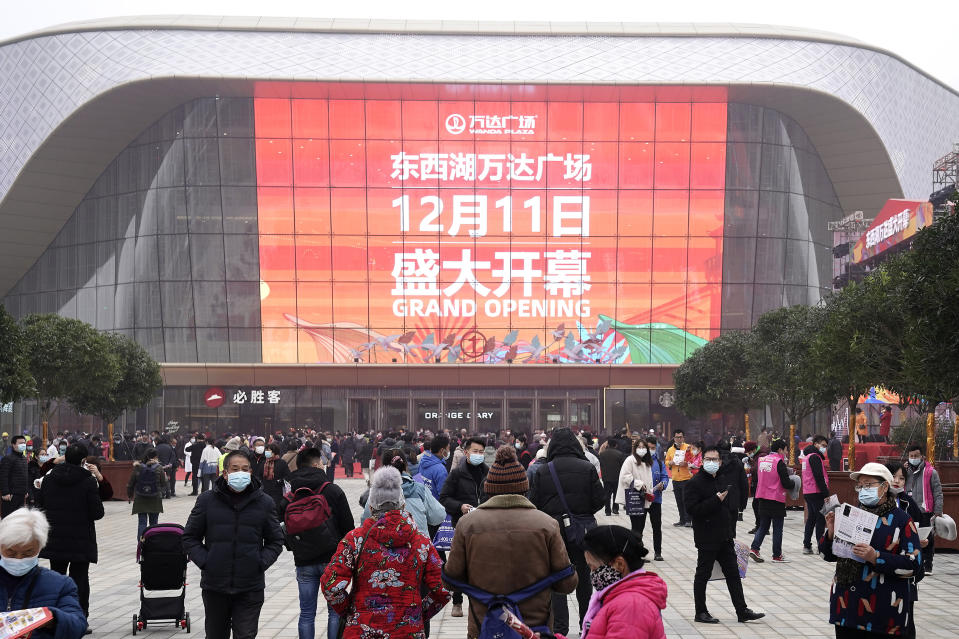 WUHAN, CHINA - DECEMBER 11: (CHINA OUT)Residents wearing masks during a new Wanda Plaza opening ceremony on December 11, 2020 in Wuhan, Hubei Province,China. Wuhan With no recorded cases of community transmissions since May, life for residents is gradually returning to normal.(Photo by Getty Images)
