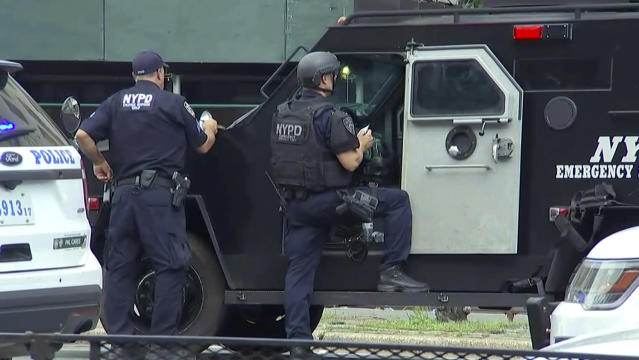 <p>In this image taken from video, New York Police Department Emergency Services officers stand by their armored vehicle outside Bronx Lebanon Hospital in New York, after a gunman opened fire there on Friday, June 30, 2017. (AP Photo/Joseph Frederick) </p>