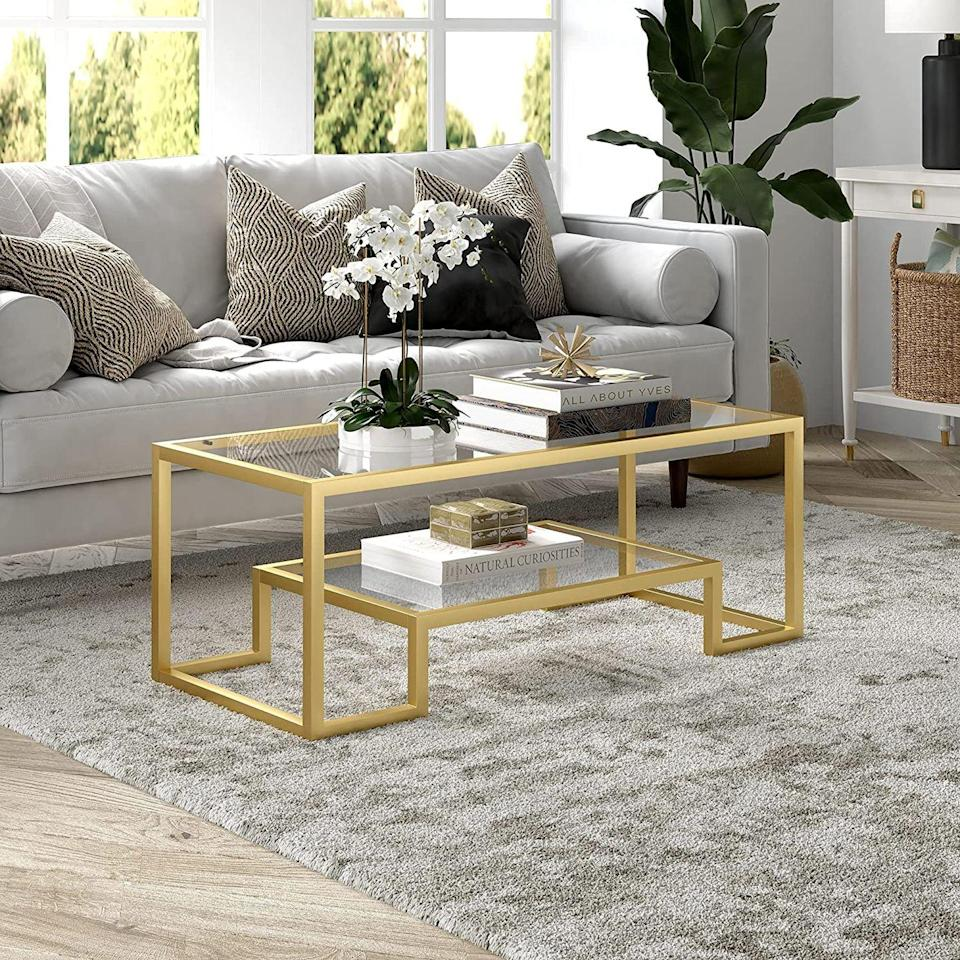 """<p>More than 1,000 Amazon reviewers have raved about how sturdy and beautiful this <a href=""""https://www.amazon.com/Henn-Hart-CT0066-Coffee-Table/dp/B07N8R9WKN?tag=syn-yahoo-20&ascsubtag=%5Bartid%7C10067.g.37858770%5Bsrc%7Cyahoo-us"""" rel=""""nofollow noopener"""" target=""""_blank"""" data-ylk=""""slk:geometric glass coffee table"""" class=""""link rapid-noclick-resp"""">geometric glass coffee table</a> is. In addition to tables, Henn & Hart is beloved for their bookshelves, bar carts, and lighting fixtures. </p><p><a class=""""link rapid-noclick-resp"""" href=""""https://www.amazon.com/stores/HennHart/page/D6B7BC7B-D72C-4A1A-BADE-006342C737A7?ref_=ast_bln&tag=syn-yahoo-20&ascsubtag=%5Bartid%7C10067.g.37858770%5Bsrc%7Cyahoo-us"""" rel=""""nofollow noopener"""" target=""""_blank"""" data-ylk=""""slk:Shop Henn & Hart on Amazon"""">Shop Henn & Hart on Amazon</a></p>"""