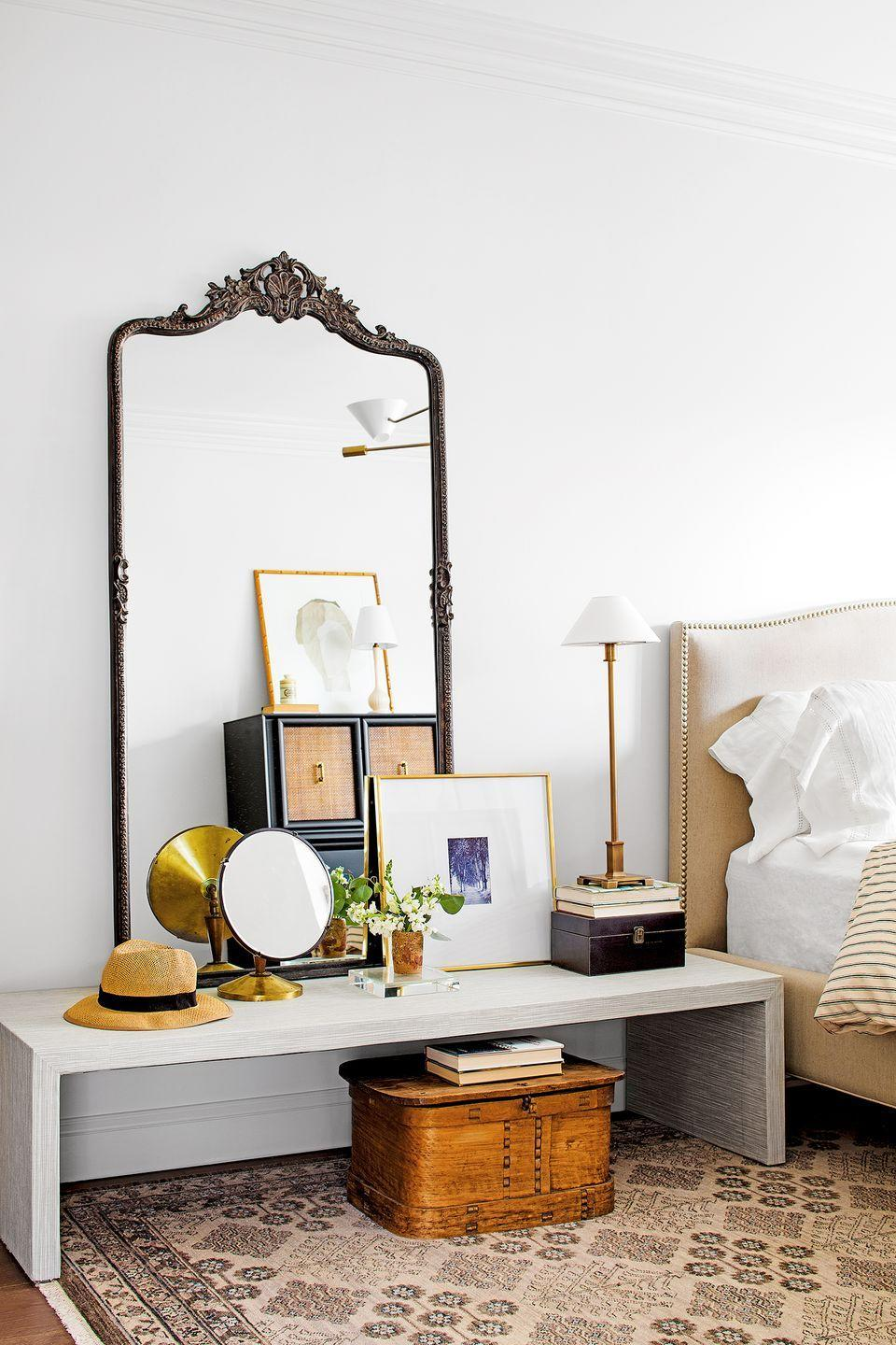 <p>If you love the idea of having both a vanity area and a nightstand, set a console table right next to your bed. Style it with your favorite accessories, including an oversized mirror, table lamp, and framed art.</p>