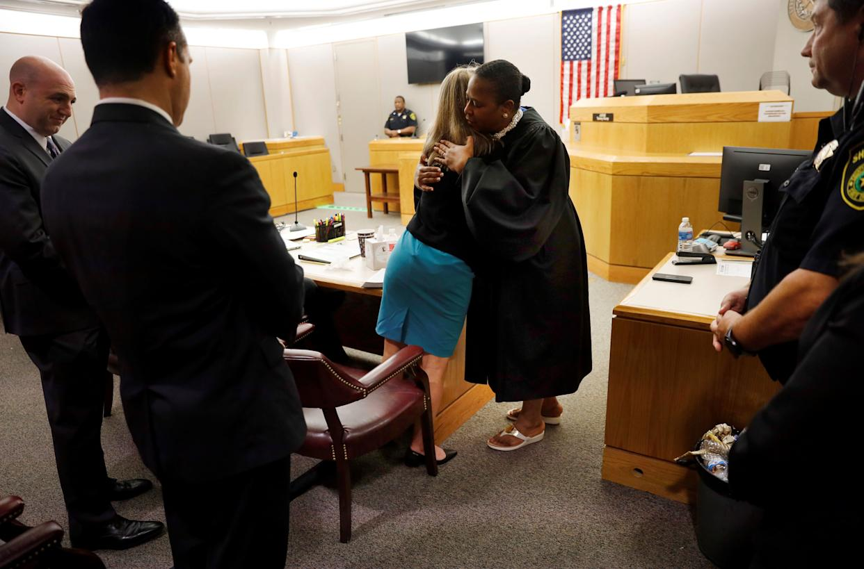 Amber Guyger gives Judge Tammy Kemp a hug at the Frank Crowley Courts Building in Dallas, Texas, U.S. October 2, 2019. (Photo: POOL New / Reuters)
