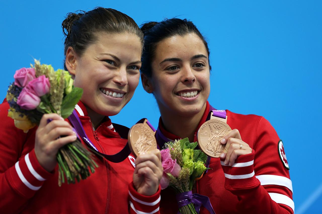 LONDON, ENGLAND - JULY 31: Bronze medallists Roseline Filion and Meaghan Benfeito of Canada pose on the podium during the medal ceremony for the Women's Synchronised 10M Platform Diving on Day 4 of the London 2012 Olympic Games at the Aquatics Centre on July 31, 2012 in London, England. (Photo by Clive Rose/Getty Images)