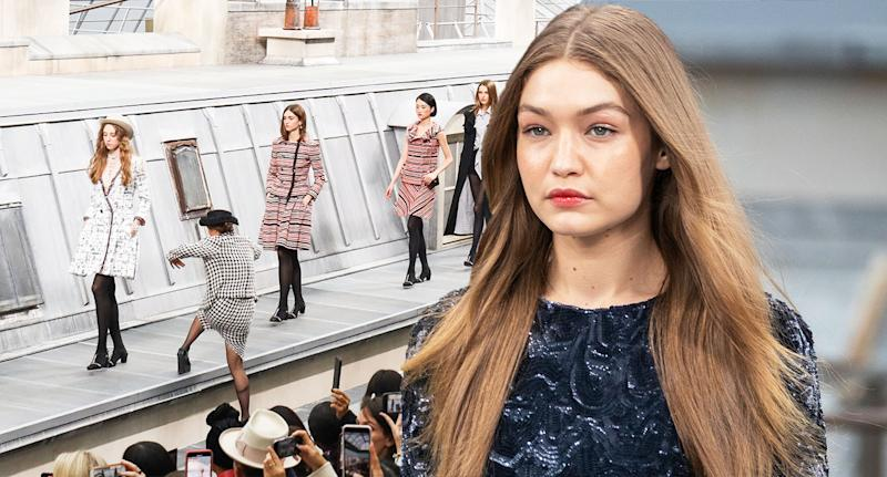 Gigi Hadid looked unimpressed as she removed a catwalk crasher at the Chanel Show. [Photo: Getty/AP]