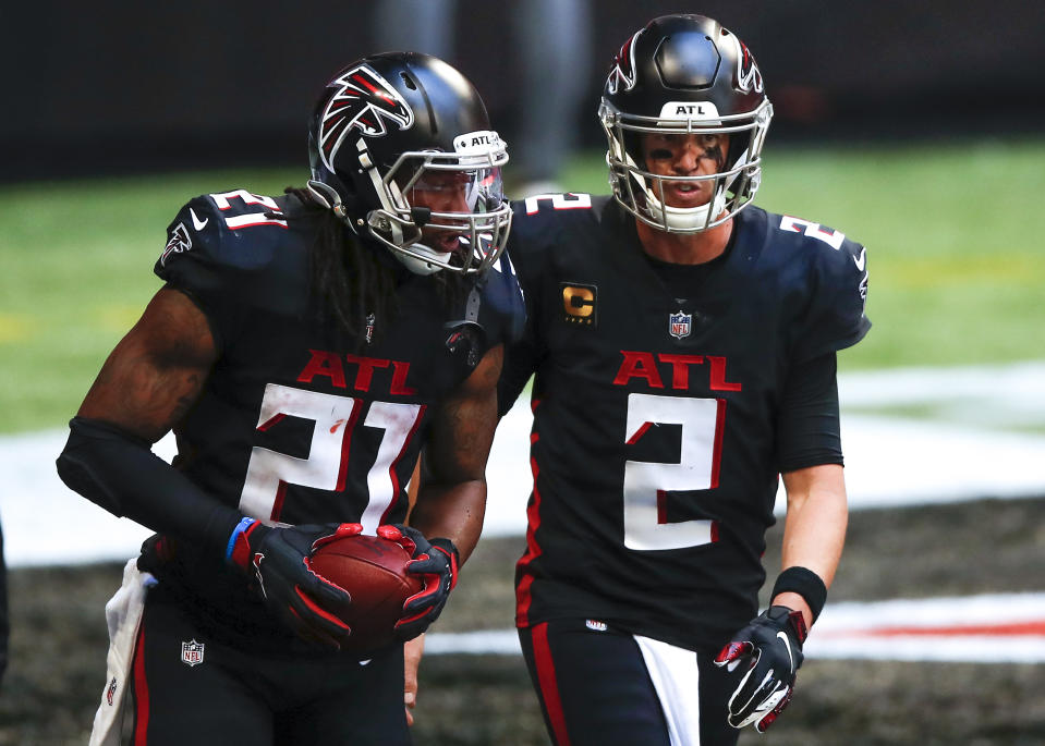 ATLANTA, GA - SEPTEMBER 27: Matt Ryan #2 reacts with Todd Gurley II #21 of the Atlanta Falcons after Gurley's touchdown during the second half of an NFL game against the Chicago Bears at Mercedes-Benz Stadium on September 27, 2020 in Atlanta, Georgia. (Photo by Todd Kirkland/Getty Images)