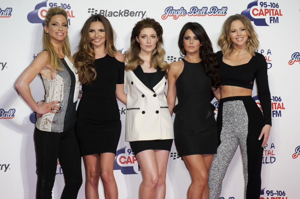 Girls Aloud from left, Sarah Harding, Nadine Coyle, Nicola Roberts, Cheryl Cole and Kimberley Walsh, arrive for the Jingle Bell Ball on Sunday, Dec. 9, 2012, in London. (Photo by Jonathan Short/Invision/AP)