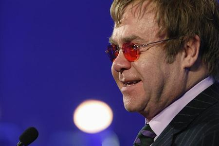 Elton John delivers remarks after receiving a lifetime achievement award for his philanthropic work from the Rockefeller Foundation in Washington