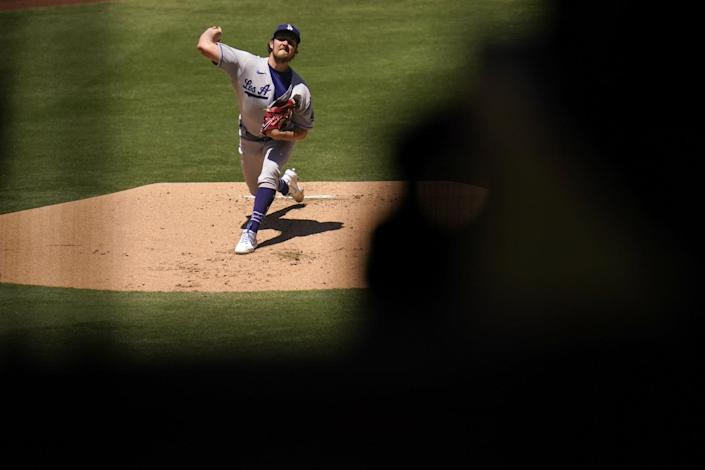Dodgers starting pitcher Trevor Bauer delivers against the San Diego Padres in the first inning Sunday.