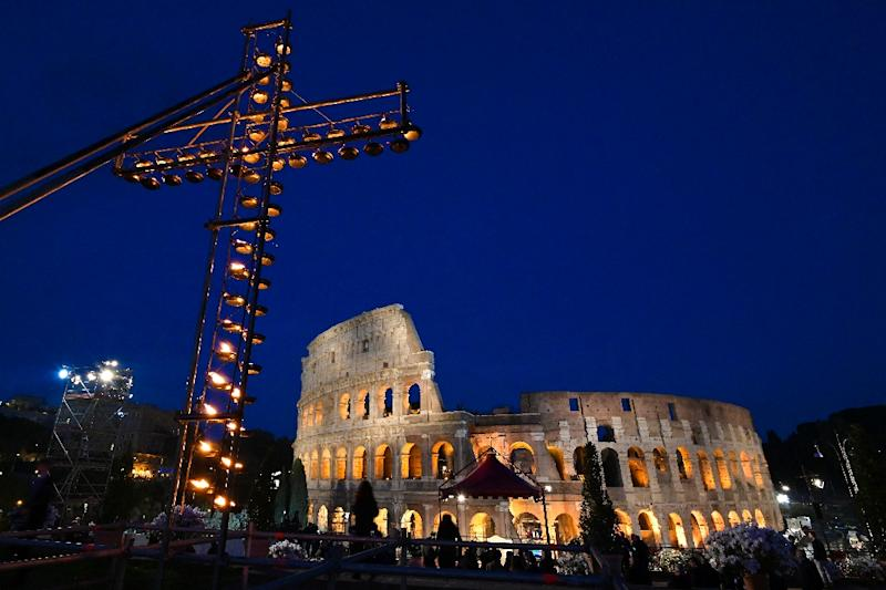 A cross lit with candles in front of the Coliseum in Rome ahead of the Way of the Cross procession (AFP Photo/Vincenzo PINTO                      )