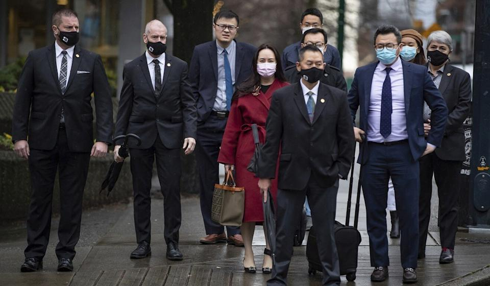 Meng Wanzhou, centre, returns to the Supreme Court of British Columbia in Vancouver on December 11, 2020. Photo: The Canadian Press via AP