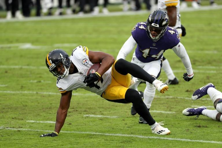 Baltimore Ravens defensive star Marlon Humphrey (44) tackles Pittsburgh's JuJu Smith-Schuster during Sunday's clash between the two teams. Humphrey has tested positive for Covid-19