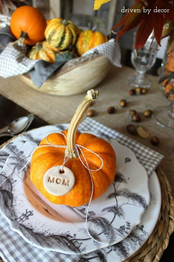 "<p>Tags punched from salt dough and tied to pumpkins double as Thanksgiving favors.</p><p><strong>Get the tutorial at <a href=""https://www.drivenbydecor.com/decorating-thanksgiving-table-breakfast-casserole-recipe/"" rel=""nofollow noopener"" target=""_blank"" data-ylk=""slk:Driven By Decor"" class=""link rapid-noclick-resp"">Driven By Decor</a>.</strong></p><p><a class=""link rapid-noclick-resp"" href=""https://www.amazon.com/besttoyhome-Artificial-Thanksgiving-Decorating-Embellishing/dp/B07FZ283HD?tag=syn-yahoo-20&ascsubtag=%5Bartid%7C10050.g.1538%5Bsrc%7Cyahoo-us"" rel=""nofollow noopener"" target=""_blank"" data-ylk=""slk:SHOP FAUX PUMPKINS"">SHOP FAUX PUMPKINS</a></p><p><strong><br></strong></p>"