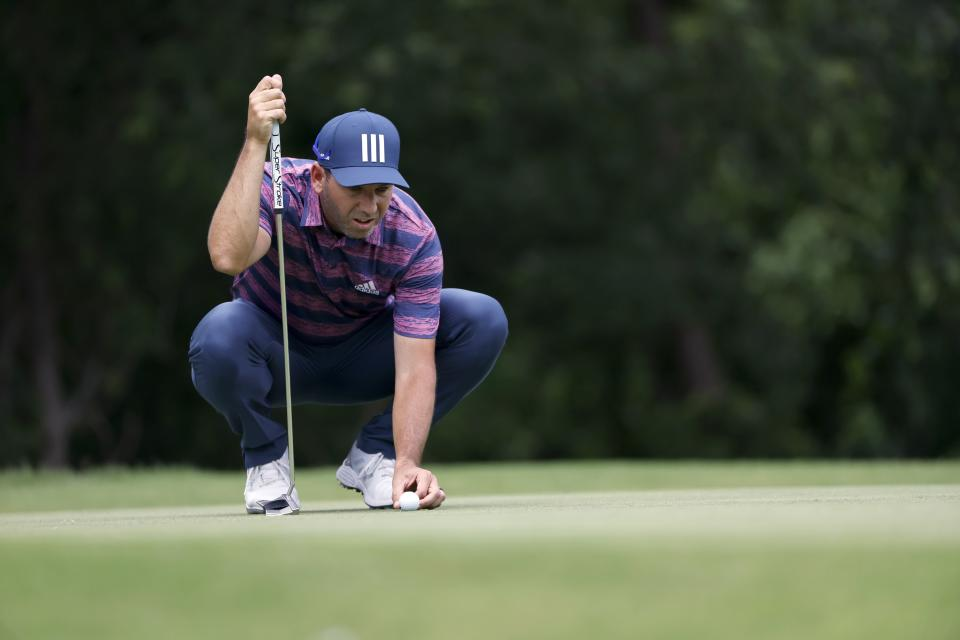 Sergio Garcia, of Spain, lines up his putt on the fifth green during the third round of the Charles Schwab Challenge golf tournament at the Colonial Country Club in Fort Worth, Texas, Saturday May 29, 2021. (AP Photo/Ron Jenkins)