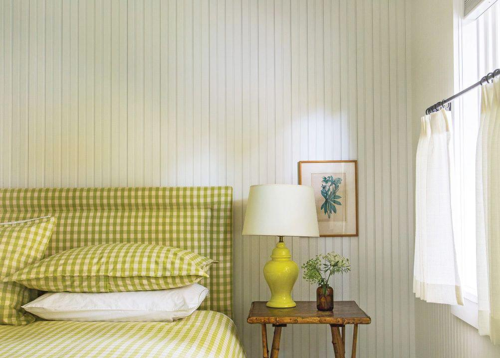"""<p>A chartreuse lamp corresponding with gingham upholstery and bedding enlivens this master bedroom designed by <a href=""""https://abneymorton.com/"""" target=""""_blank"""">Abney Morton Interiors</a>. The color is unexpected, but works wonders to keep the space light and casual enough for a lake cabin while still being grownup and sophisticated.</p><p><em>Check out <a href=""""https://go.redirectingat.com/?id=74968X1525080&xs=1&url=https%3A%2F%2Fwww.westelm.com%2Fshop%2Flighting%2F&sref=https%3A%2F%2Fwww.housebeautiful.com%2Froom-decorating%2Fbedrooms%2Ftips%2Fg2166%2Funique-bedroom-lighting-ideas%2F%3Fpre%3Droom-decorating%252Fbedrooms%252Ftips%252F%26prefix%3Dg%26id%3D2166%26del%3D%26variantId%3D%26post%3D%252Funique-bedroom-lighting-ideas%26slide%3D7"""" target=""""_blank"""">West Elm</a> for stylish bedroom lighting, and <strong>shop our pick </strong>below:</em></p><p><em></em><a class=""""body-btn-link"""" href=""""https://go.redirectingat.com/?id=74968X1525080&xs=1&url=https%3A%2F%2Fwww.westelm.com%2Fproducts%2Fmodern-totem-table-lamp-small-w3511%2F&sref=https%3A%2F%2Fwww.housebeautiful.com%2Froom-decorating%2Fbedrooms%2Ftips%2Fg2166%2Funique-bedroom-lighting-ideas%2F%3Fpre%3Droom-decorating%252Fbedrooms%252Ftips%252F%26prefix%3Dg%26id%3D2166%26del%3D%26variantId%3D%26post%3D%252Funique-bedroom-lighting-ideas%26slide%3D7"""" target=""""_blank"""">BUY NOW</a> <strong><em>West Elm Modern Totem Table Lamp, $129</em></strong></p>"""