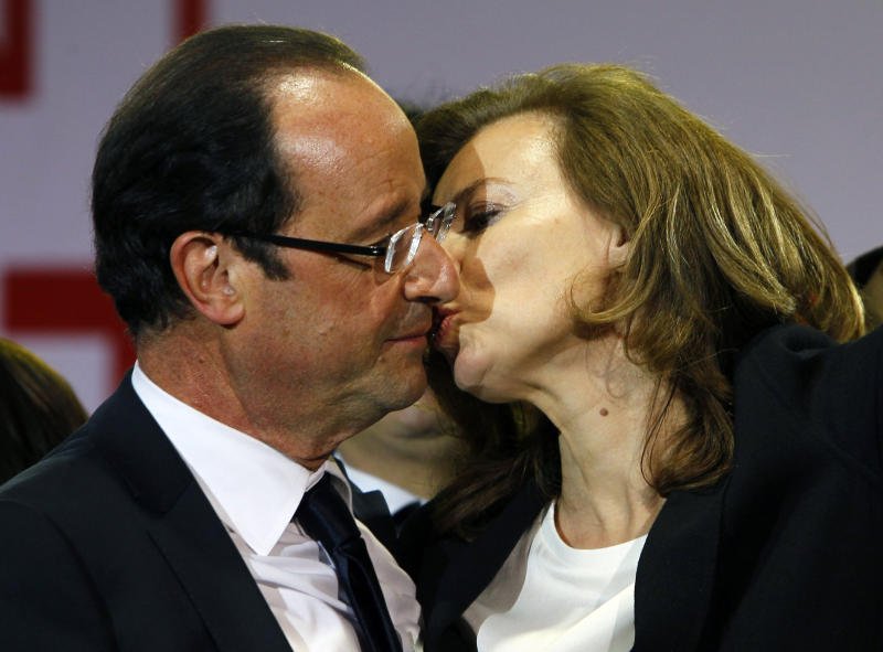 "FILE - This Sunday, May 6, 2012, file photo shows French president-elect Francois Hollande kissing his companion, Valerie Trierweiler, after greeting crowds gathered to celebrate his election victory in Bastille Square in Paris, France. After centuries of lacking a French word for the sloppy Gallic export ""to French kiss,"" a verb has finally been given its rightful place in the French dictionary. ""Galocher"", to kiss with tongues, is among new entries added to the ""Petit Robert"" 2014 edition, which hits the shops Thursday. (AP Photo/Francois Mori, File)"