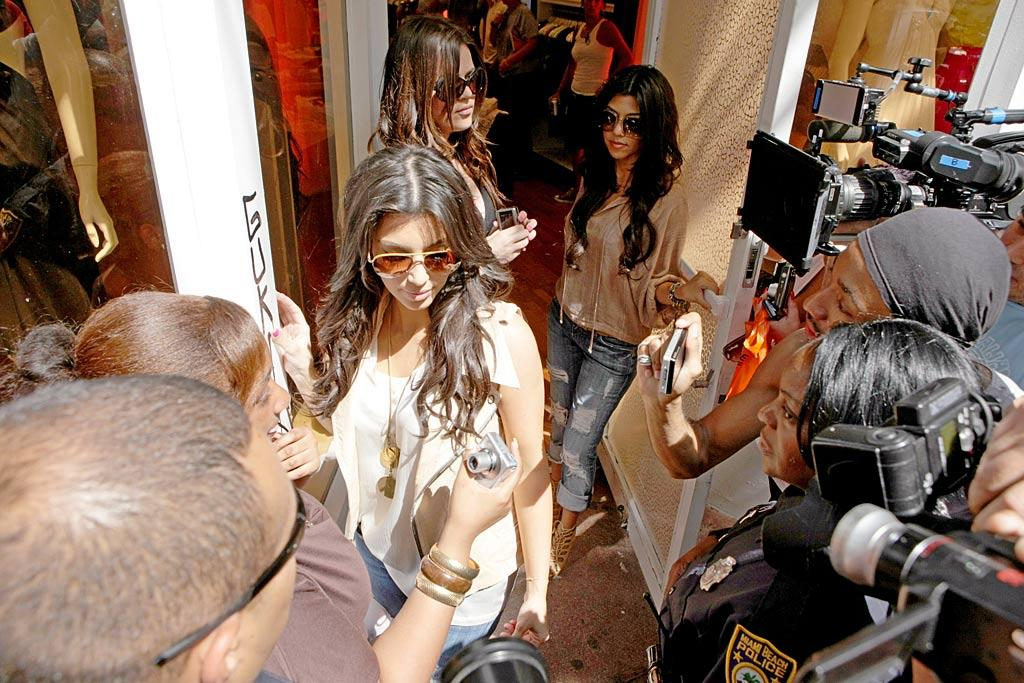 "Reality starlets Kim, Khloe, and Kourtney Kardashian flew to Miami on Tuesday to assess the damage to their boutique Dash. The store was vandalized with graffiti the day before it was scheduled to open. SDFL/Prahl/<a href=""http://www.splashnewsonline.com"" target=""new"">Splash News</a> - May 19, 2009"