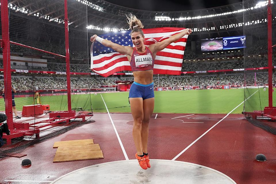 <p>USA's Valarie Allman jumps for joy after winning the gold medal in the Women's Discus Final at Olympic Stadium on August 2.</p>