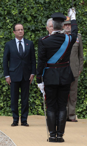 Italian Premier Mario Monti, right, and French President Francois Hollande listen to the national anthems during their bilateral meeting at Villa Madama in Rome, Tuesday, Sept. 4, 2012. (AP Photo/Gregorio Borgia)