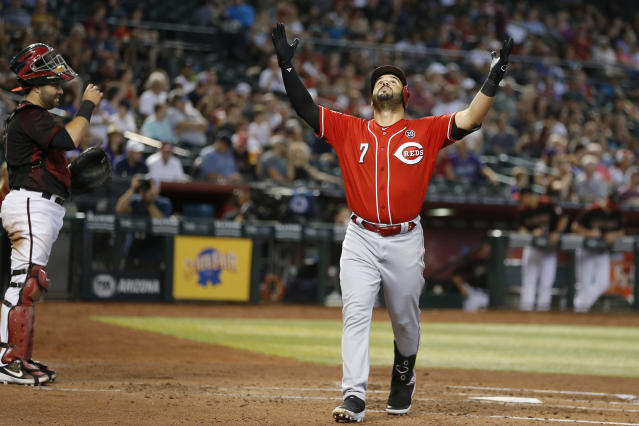 Cincinnati Reds' Eugenio Suarez celebrates after hitting a solo home run against the Arizona Diamondbacks in the fourth inning during a baseball game, Sunday, Sept. 15, 2019, in Phoenix. (AP Photo/Rick Scuteri)