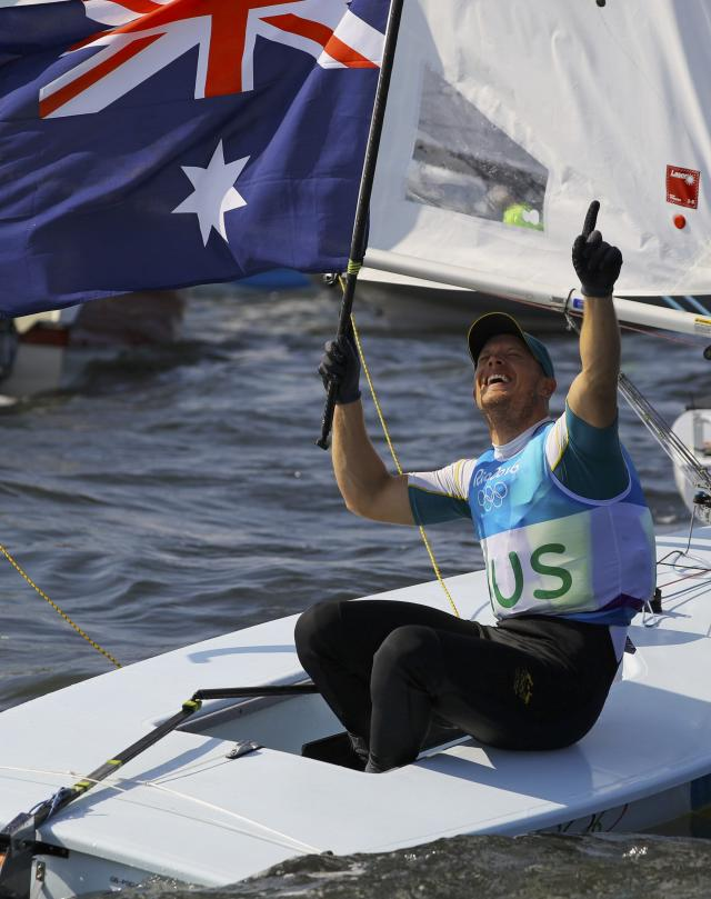 2016 Rio Olympics - Sailing - Preliminary - Men's One Person Dinghy - Laser - Medal Race - Marina de Gloria - Rio de Janeiro, Brazil - 16/08/2016. Tom Burton (AUS) of Australia celebrates winning gold medal. REUTERS/Brian Snyder FOR EDITORIAL USE ONLY. NOT FOR SALE FOR MARKETING OR ADVERTISING CAMPAIGNS.