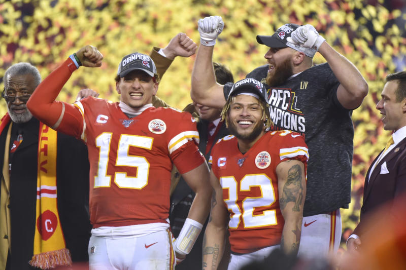 Kansas City Chiefs' Patrick Mahomes (15), Travis Kelce and Tyrann Mathieu (32) celebrate after the NFL AFC Championship football game against the Tennessee Titans Sunday, Jan. 19, 2020, in Kansas City, MO. The Chiefs won 35-24 to advance to Super Bowl 54. (AP Photo/Ed Zurga)