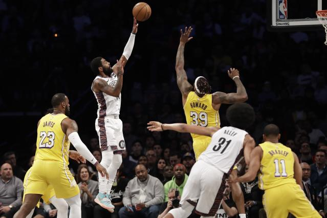 Brooklyn Nets' Kyrie Irving (11) shoots over Los Angeles Lakers' Dwight Howard (39) during the first half of an NBA basketball game Thursday, Jan. 23, 2020, in New York. (AP Photo/Frank Franklin II)
