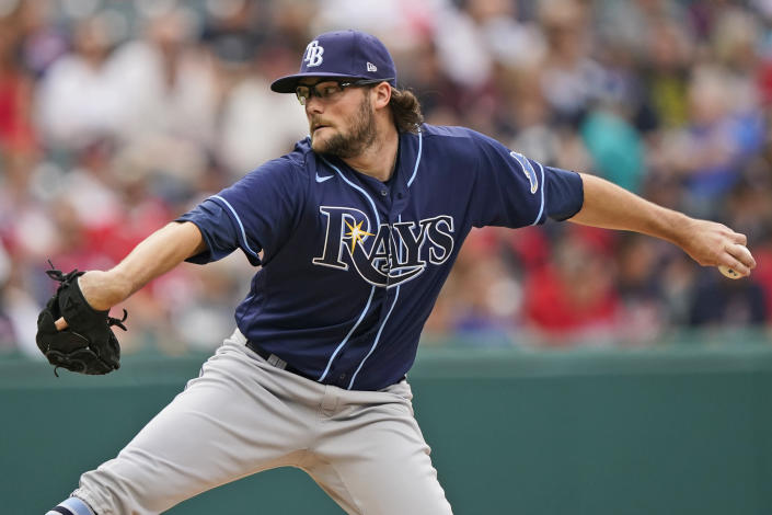 Tampa Bay Rays starting pitcher Josh Fleming delivers in the first inning of the team's baseball game against the Cleveland Indians, Friday, July 23, 2021, in Cleveland. (AP Photo/Tony Dejak)