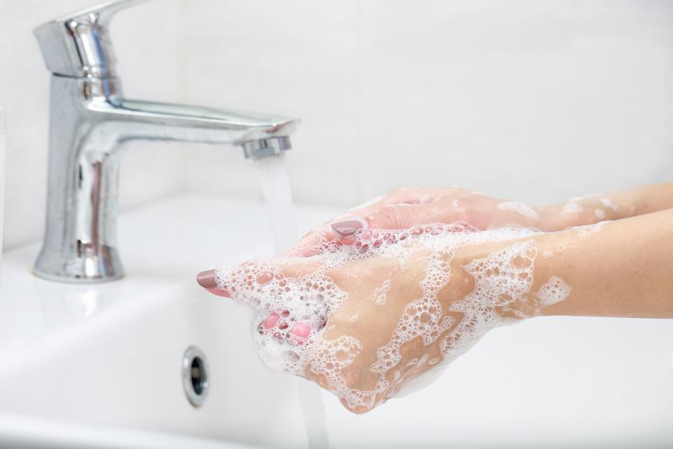 Close-Up Of Woman Washing Hands