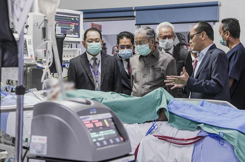 Prime Minister Tun Dr Mahathir Mohamad checks in on fireman Muhammad Adib Mohd Kassim at the National Heart Institute in Kuala Lumpur November 28, 2018. — Picture by Firdaus Latif
