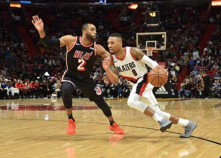 Dec 13, 2017; Miami, FL, USA; Portland Trail Blazers guard Damian Lillard (0) dribbles the ball as Miami Heat guard Wayne Ellington (2) defends during the second half at American Airlines Arena. Steve Mitchell-USA TODAY Sports
