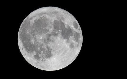 The full Harvest moon rises over Somerset - Credit: Matt Cardy/Getty Images