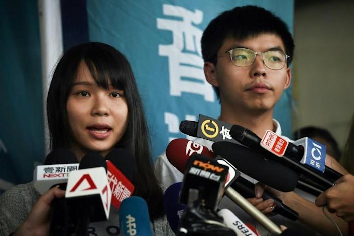 Agnes Chow (left) and Joshua Wong (right) are also being prosecuted for taking part in last year's huge pro-democracy protests