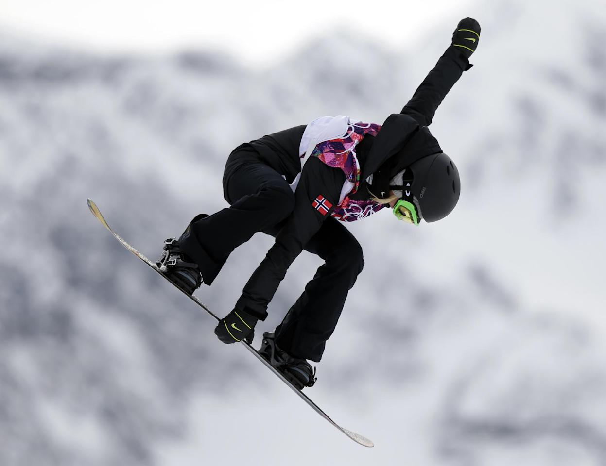 Norway's Silje Norendal takes a jump in her first run in the women's snowboard slopestyle final at the 2014 Winter Olympics, Sunday, Feb. 9, 2014, in Krasnaya Polyana, Russia. (AP Photo/Andy Wong)