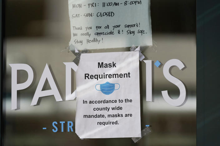 "A ""Mask Requirement"" sign on a door on Sept. 10 in Salt Lake City. (Rick Bowmer/AP)"