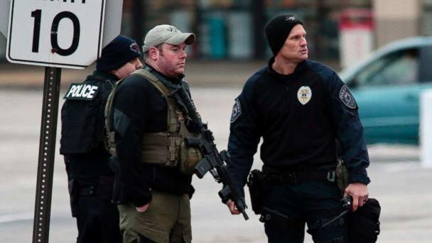 PHOTO: Police officers work the scene where two St. Louis County officers were shot and a man barricaded himself inside a home, Dec. 14, 2017, in the St. Louis County town of Bellefontaine Neighbors, Mo. Officers are trying to negotiate his surrender. (Robert Cohen/St. Louis Post-Dispatch via AP)