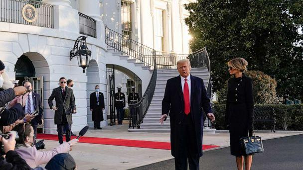 PHOTO: President Donald Trump and first lady Melania Trump stop to talk with the media as they walk to board Marine One on the South Lawn of the White House, Jan. 20, 2021, in Washington, D.C. (Alex Brandon/AP)