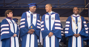 The Howard University Board of Trustees announces its unanimous decision, upon the recommendation of President Wayne A. I. Frederick, to name the Law School Library as the Vernon E. Jordan, Jr., Esq. Law Library in honor of the proud and devoted Howard alumnus, and Civil Rights icon. Pictured L to R: Valerie Jarrett, Jordan, President Barack Obama, and President Frederick at the University's 2016 commencement ceremony.
