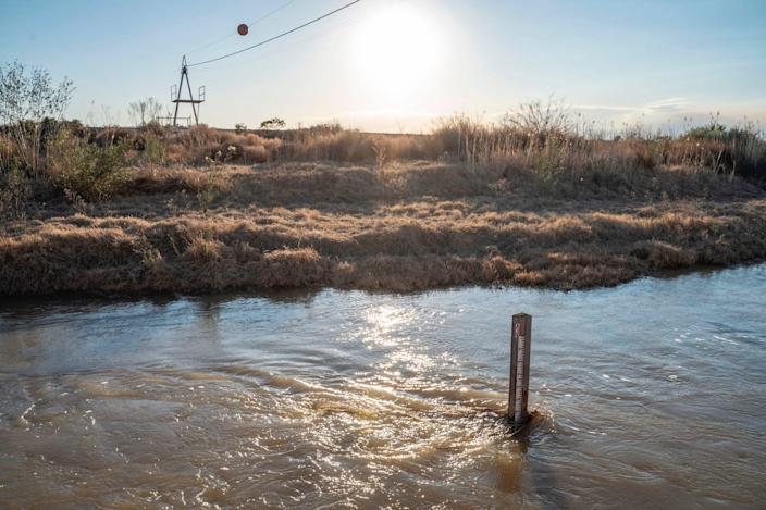 """A depth gauge is seen in the Rio Grande on January 29, 2020 in Presidio, Texas. <p class=""""copyright"""">Paul Ratje/AFP via Getty Images</p>"""