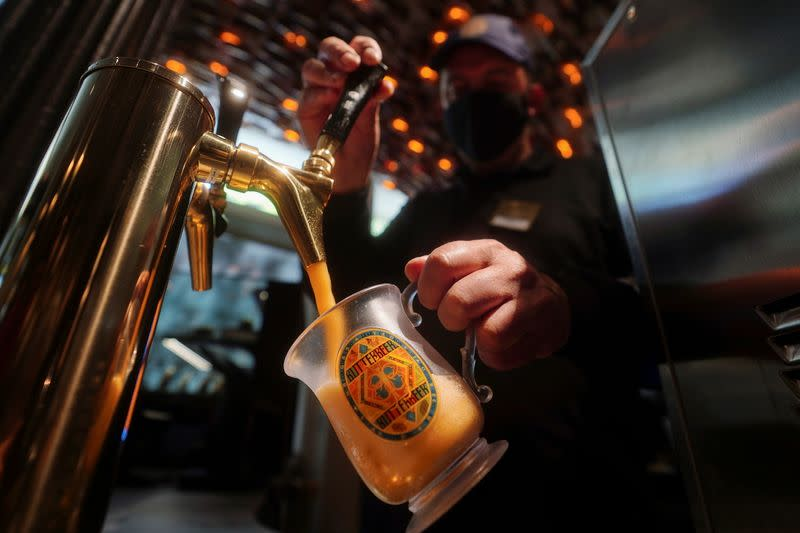 Thierry Sighel draws a mug of draft Butterbeer in New York City