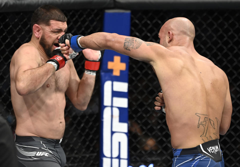 LAS VEGAS, NEVADA - SEPTEMBER 25: (R-L) Robbie Lawler punches Nick Diaz in their middleweight fight during the UFC 266 event on September 25, 2021 in Las Vegas, Nevada. (Photo by Jeff Bottari/Zuffa LLC)