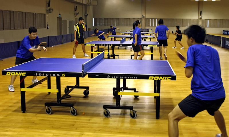 Singapore, SINGAPORE: TO GO WITH STORY Singapore-sports-school,sched Students practise table tennis during a training session, 27 November 2006, at the Singapore Sports School. Singapore's remarkable performance at the Asian Games in Doha has given a major boost to the wealthy city-state's ambitious sports programmes. AFP PHOTO/ROSLAN RAHMAN (Photo credit should read ROSLAN RAHMAN/AFP via Getty Images)