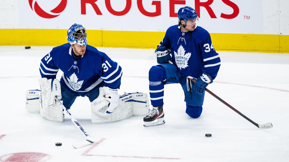 TORONTO, ON - FEBRUARY 8: Frederik Andersen #31 and Auston Matthews #34 of the Toronto Maple Leafs warm up before facing the Vancouver Canucks at the Scotiabank Arena on February 8, 2021 in Toronto, Ontario, Canada. (Photo by Kevin Sousa/NHLI via Getty Images)